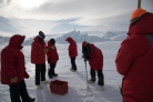 Learning to drill out sea ice cracks. (Credit: Justin)