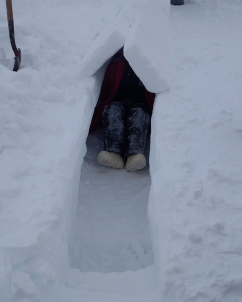 Sitting in a snow trench.
